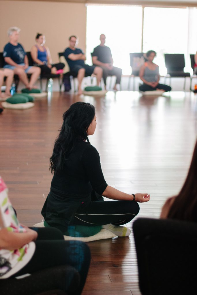 A woman meditating during a Mindful-Way class.